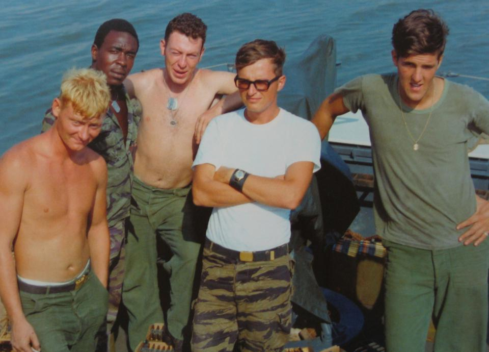 During his naval military service in the Vietnam War, Kerry (R) was awarded the Bronze Star for saving the life of a serviceman when he served as a Swift Boat officer aboard a river patrol boat in the Mekong Delta in Vietnam.