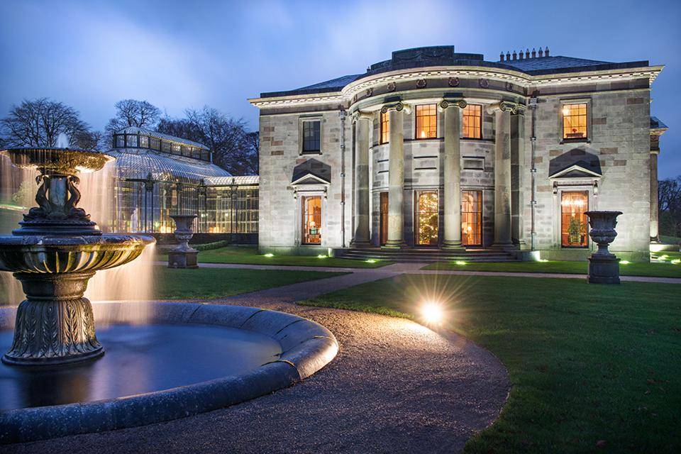Ballyfin in Ireland is an historic mansion with a fountain in front of it.
