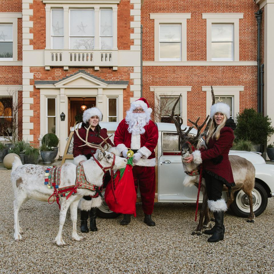 Santa Claus and his reindeer are in front of Heckfield Place hotel in England.