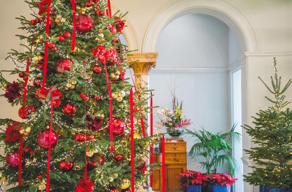 There is a Christmas tree with red ribbons in the lobby of Reid's Palace hotel in Madeira