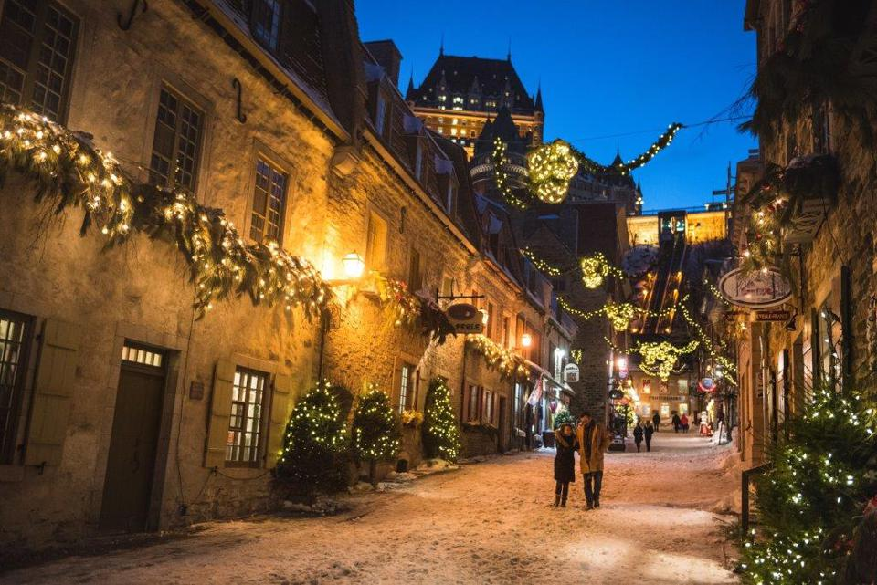 A quiet street in Quebec City, Canada, is decorated with Christmas lights