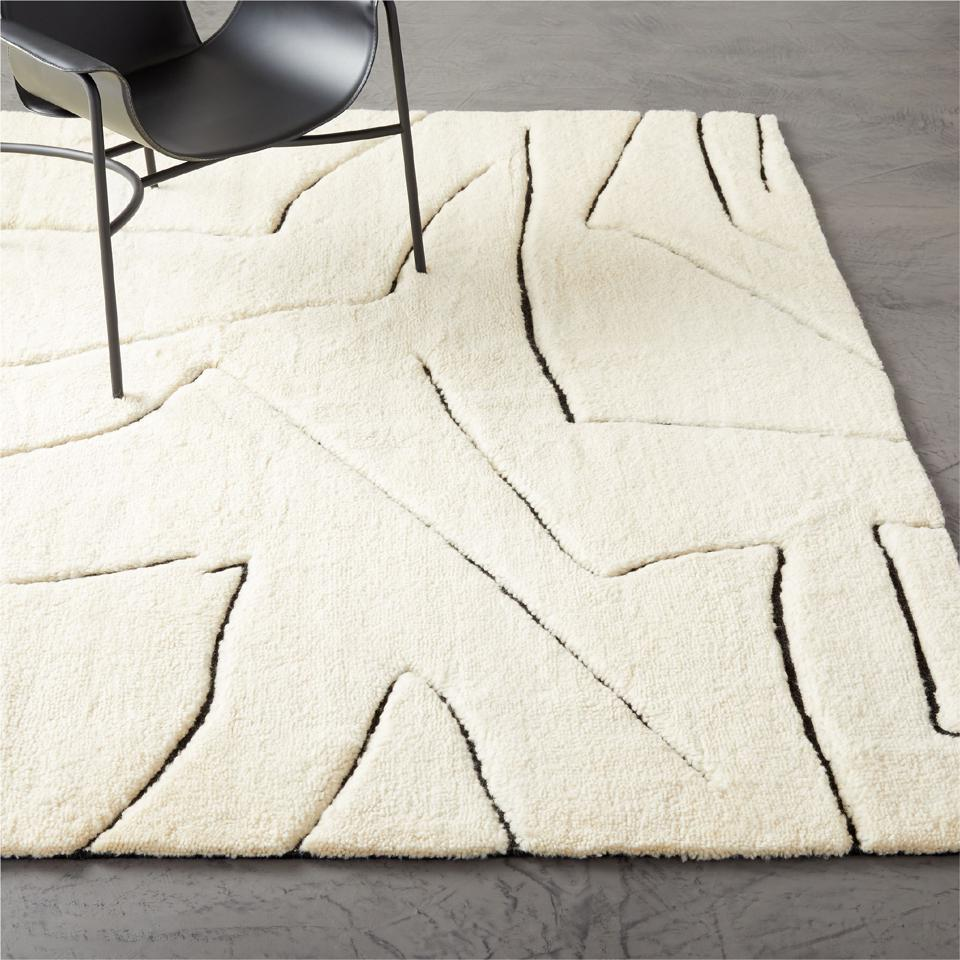 A hand-knotted rug with white New Zealand wool.