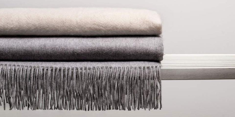 A beautiful cashmere throw in two neutral colors.