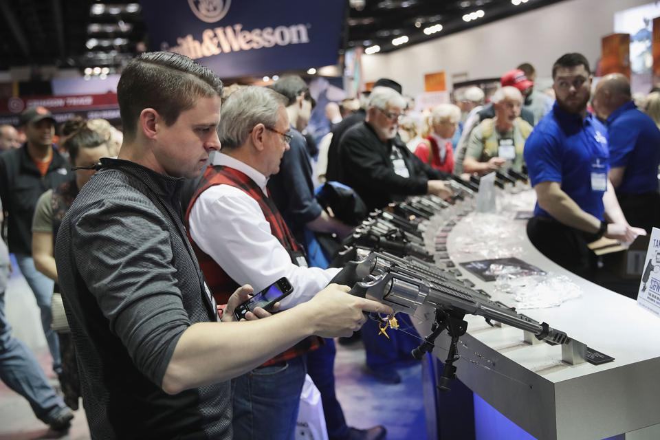 Gun Enthusiasts Attend NRA Annual Meeting In Indianapolis
