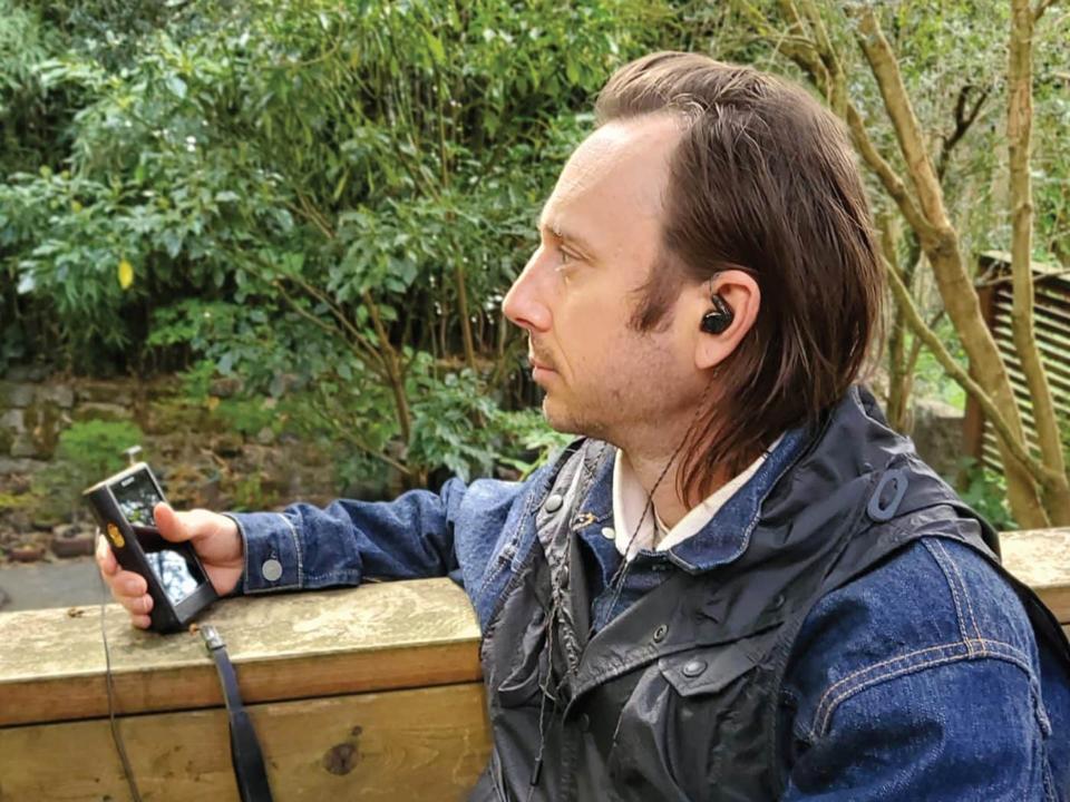 Man wearing Campfire Audio Dorado 2020 earphones