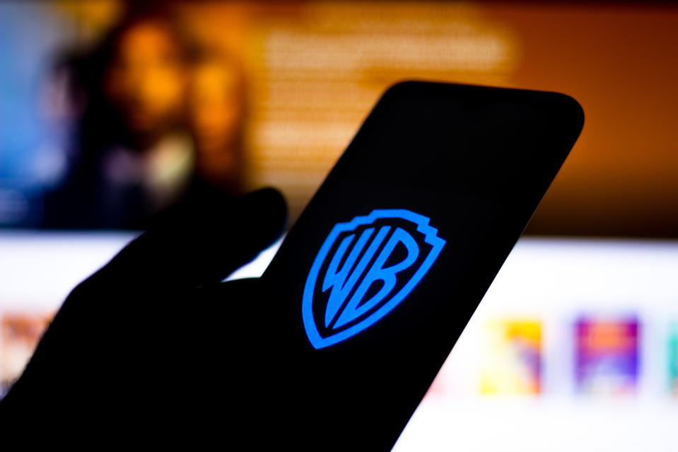 In this photo illustration the Warner Bros. logo seen...