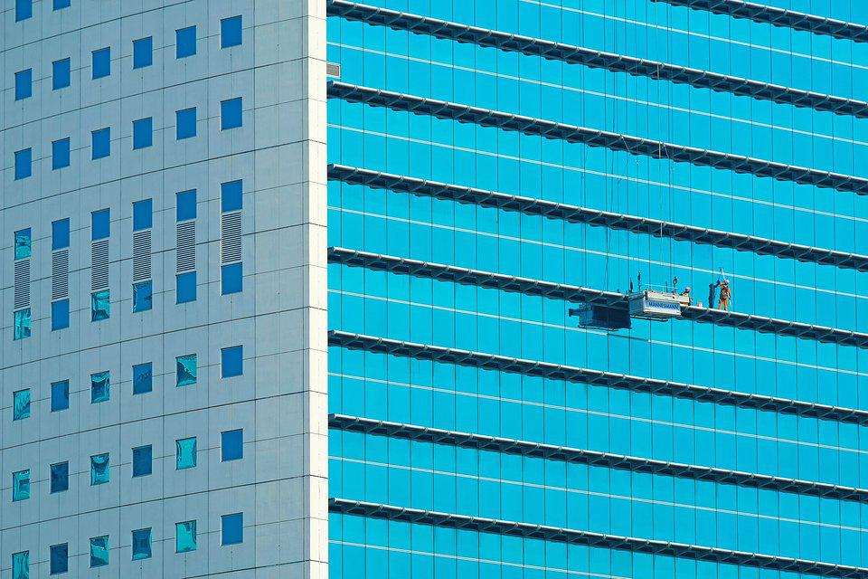Window cleaners in tall building Jakarta.