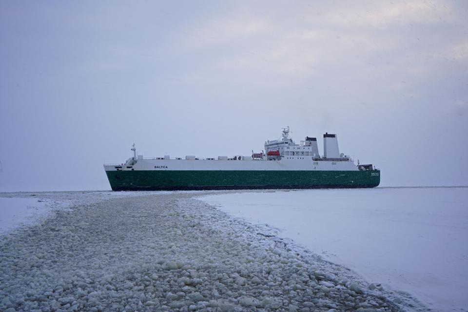 Icebreaker calving out a path for a cargo ship in the Arctic in 2018
