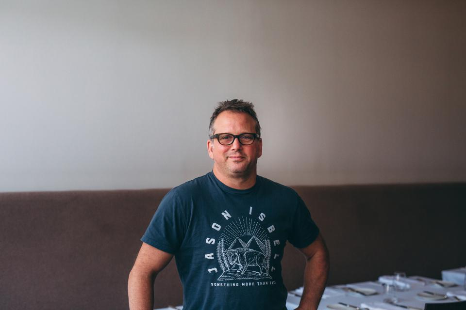 Chef Paul Kahan, the winner of James Beard Awards for Outstanding Chef and Best Chef in the Midwest, proudly shows his appreciation for one of his favorite musicians.