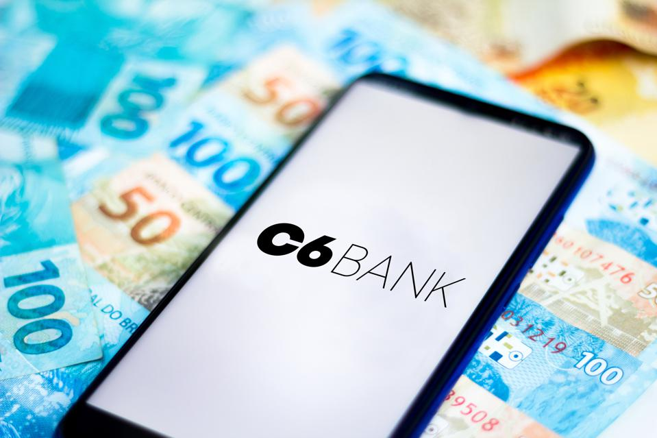 In this photo illustration the C6 Bank logo seen displayed...