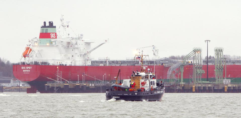 The U.S. Coast Guard vessel Shackle, seen in front of the oil tanker SKS Spey, participates in an oi