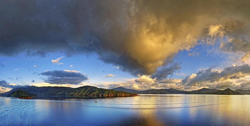 Small Boat at Sunrise, Cloudy Sky, Marlborough Sounds, South Island, New Zealand