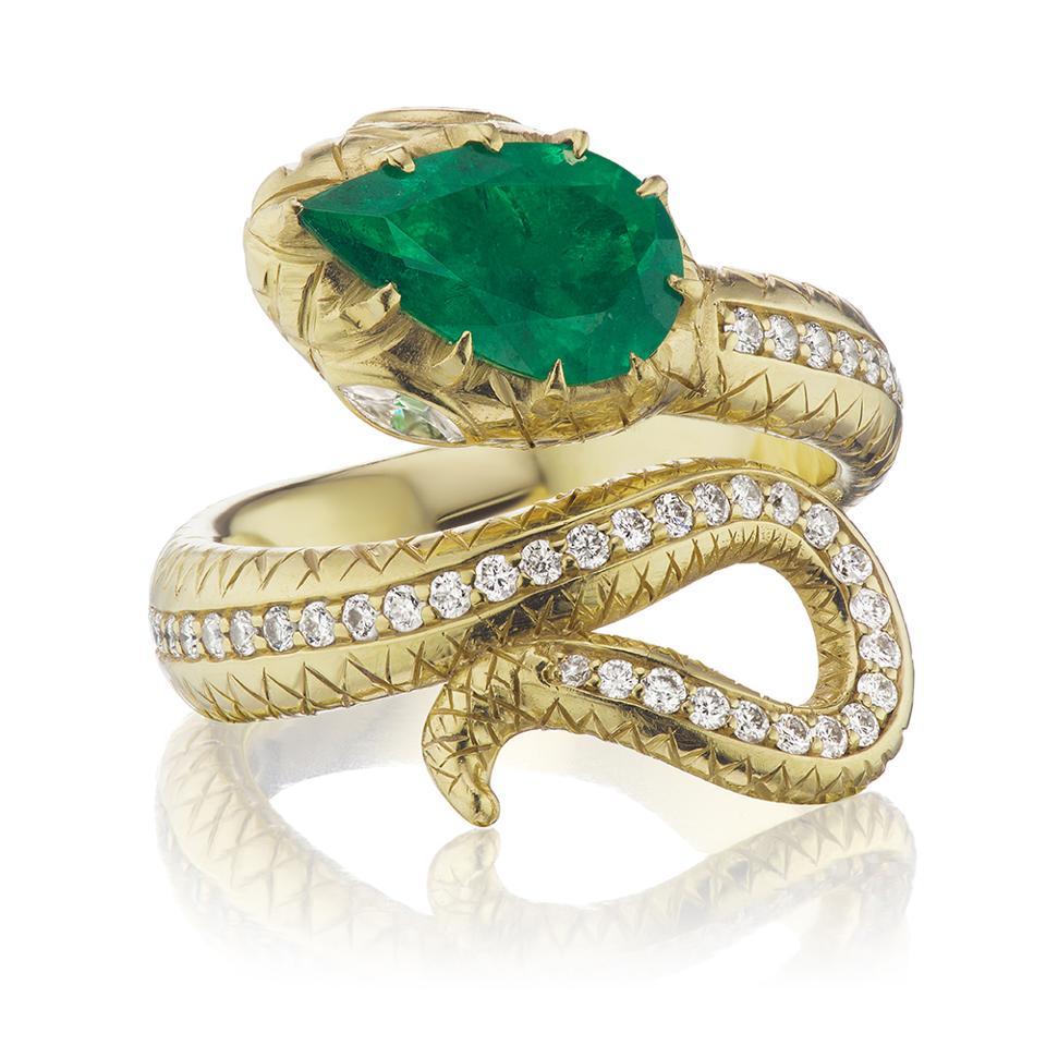 Snake ring by Jenna Blake in18k yellow gold, Muzo emerald and diamonds. $14,800