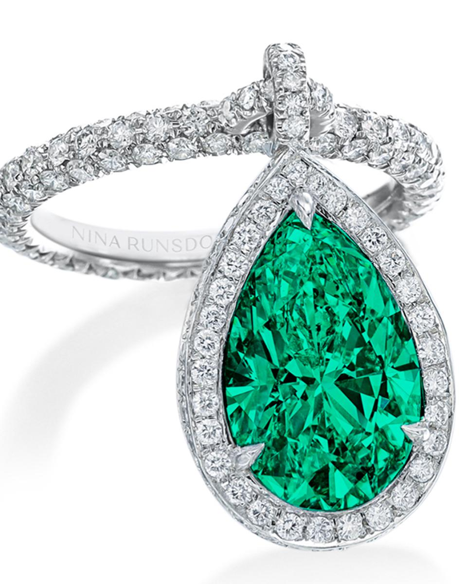 Emerald and gold dangle ring by Nina Runsdorf, in platinum mounting, with Muzo pear shaped emerald and pavé diamonds. $81,500