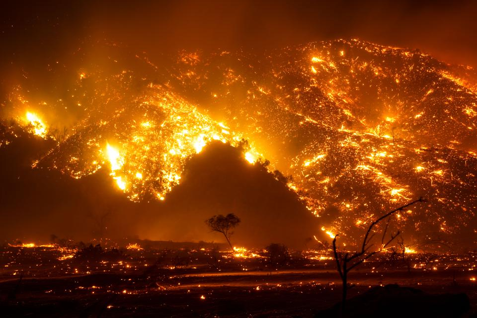 3 Dec 2020: California wildfires continue with dangerous dry wind conditions from Santa Ana winds causing the Bond Fire in Silverado Canyon Fire, Orange County, California.