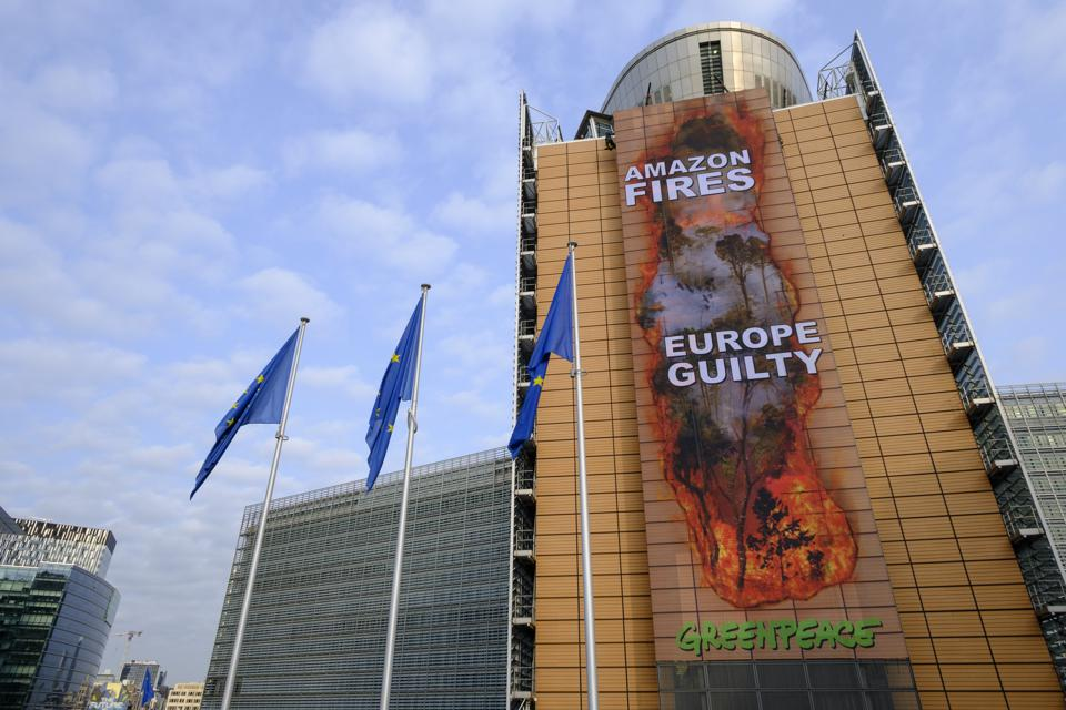 11 Sep 2020: Greenpeace activists roll down a banner outside the EU Commission Headquarters in Brussels to protest against the ongoing damage to the Amazon rainforest.