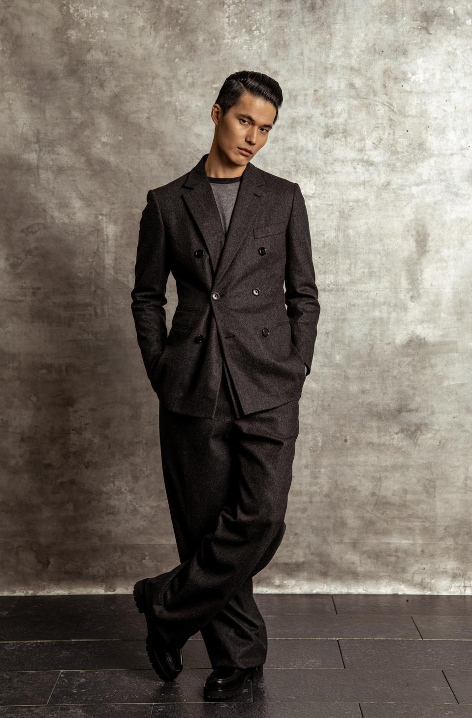 Hermès   Prices & descriptions for Look 1:  Wool flannel suit $5,100; Cashmere sweater $1,275; Boots $1,150   Prices & descriptions for Look 2:  Deerskin hooded sweatshirt $12,800; Cashmere sweater $1,275; Boots $1,150; Wool flannel pants sold as suit - $5,100   https://www.hermes.com/us/en/    @hermes