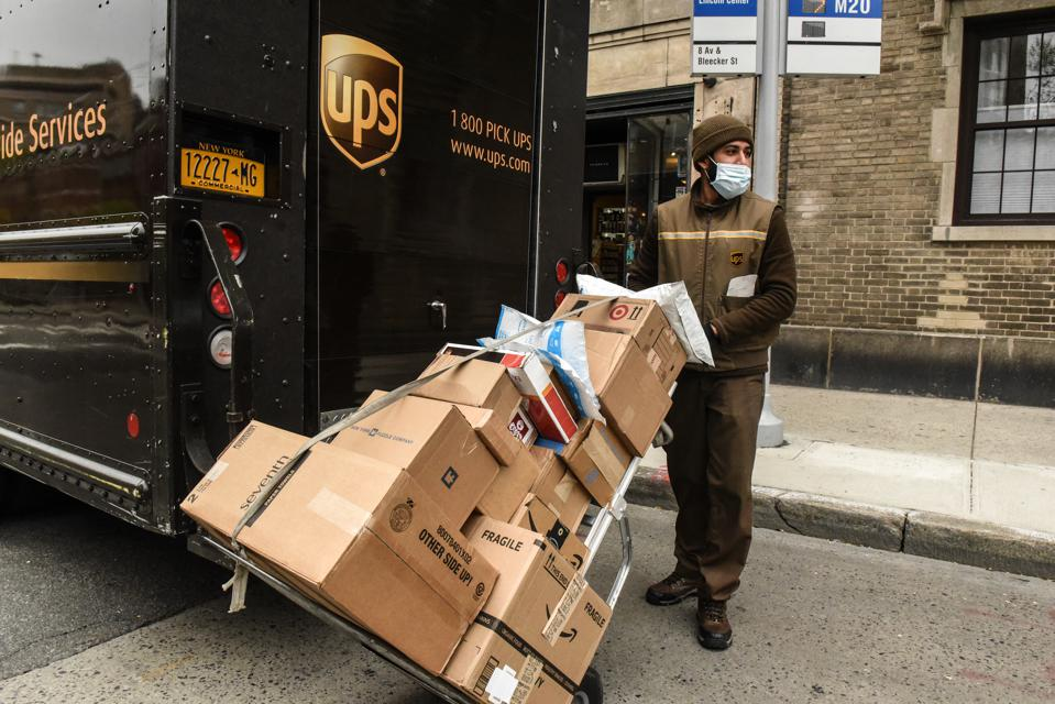 UPS struggles to keep up with demand for its delivery services.