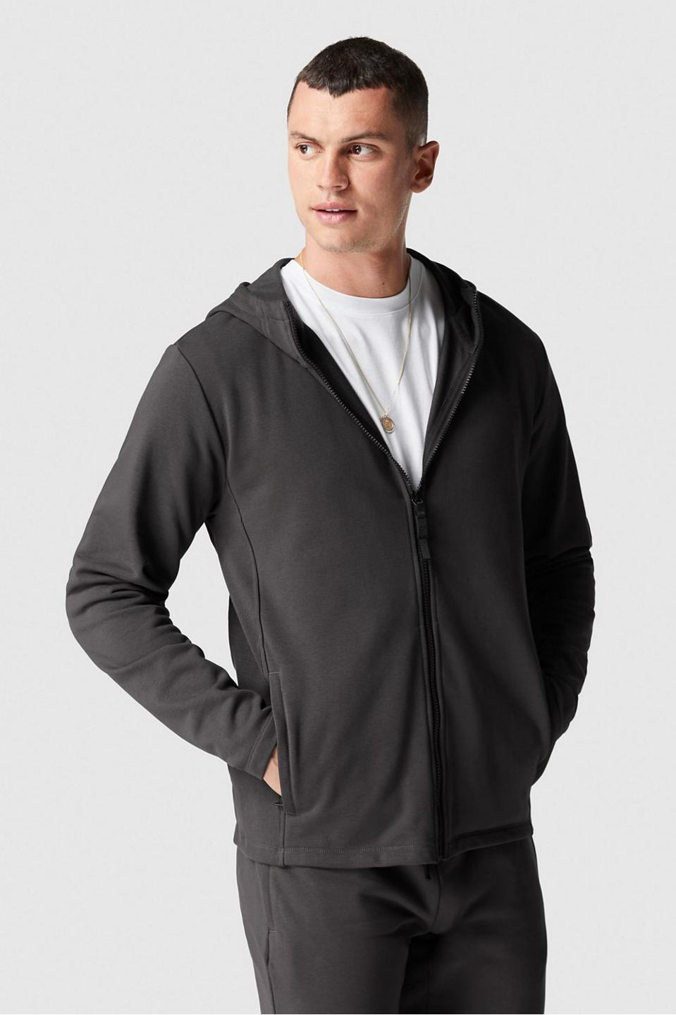 The Courtside Full Zip Hoodie features external and hidden pockets, anti-stink protection, sweat wicking fabric and zip pockets to elevate your workout look