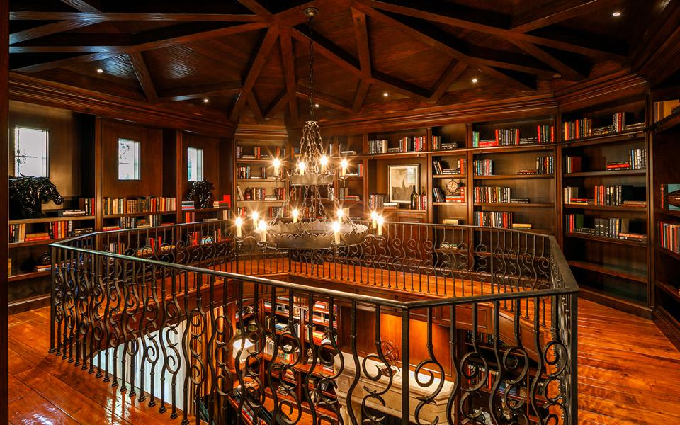 A two-story library with wood ceilings and walls.