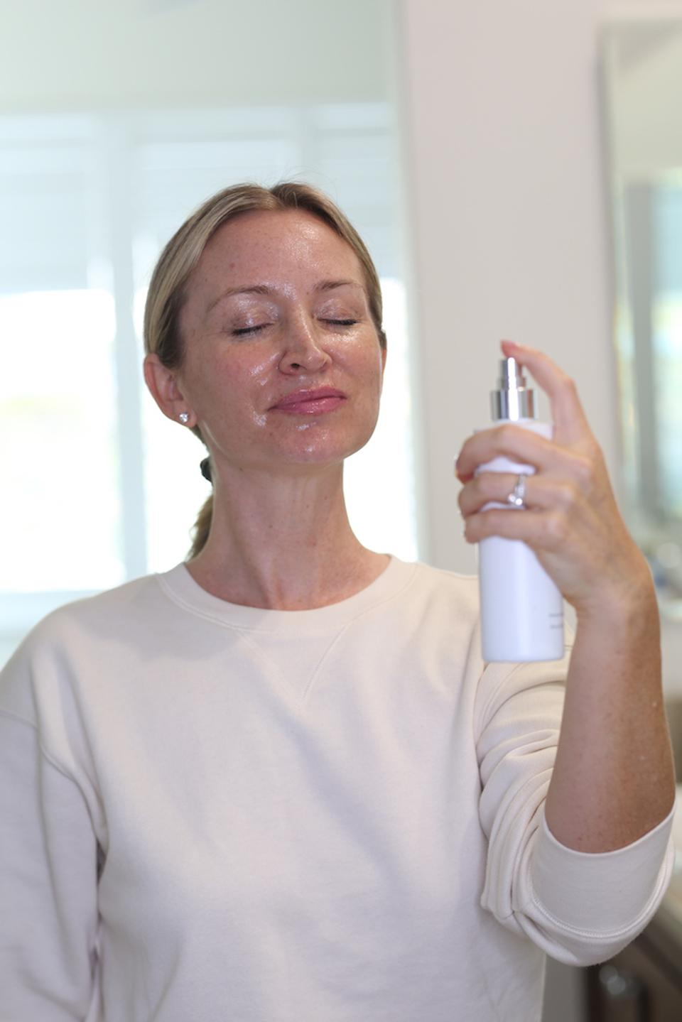 woman applying face mist