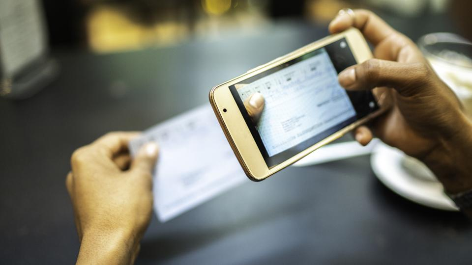 A woman deposits a check using her cellphone.