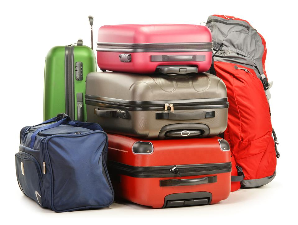 A bundle of colorful suitcases and bags