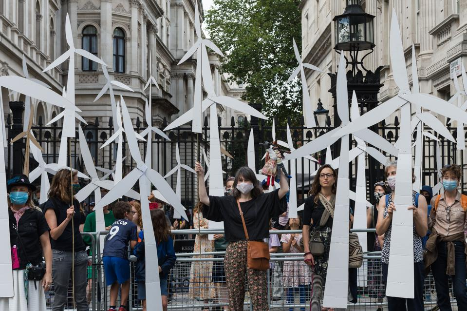 26 Jul 2020: Parents and children hold handmade wind turbines, creating a wind farm, outside Downing Street to call for a green economic recovery after the coronavirus pandemic in the U.K.