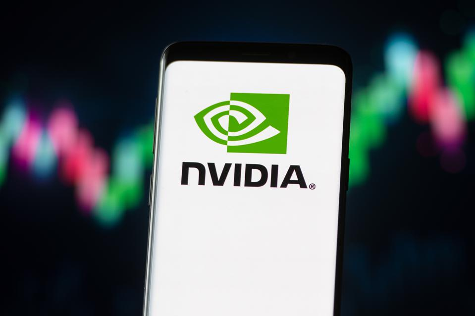 In this photo illustration a Nvidia logo seen displayed on a...
