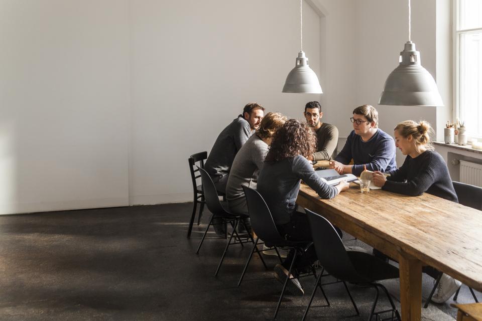 Coworkers having a meeting in modern office