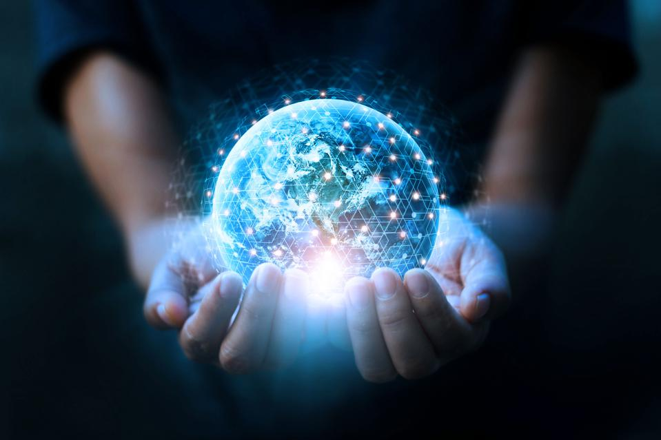 Hands holding blue earth covered with digital points/network connections. Global networking/data exchange concept. Elements of this image furnished by NASA.