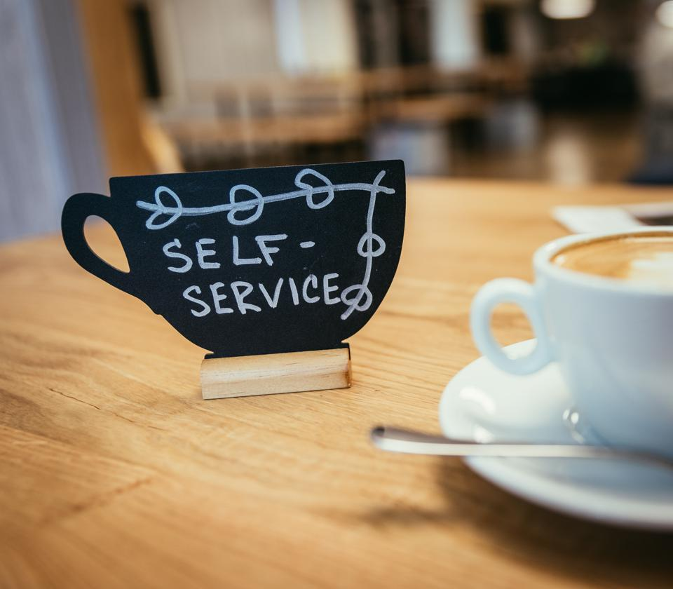 Self-service in a café: cup of Italian cappuccino in the morning