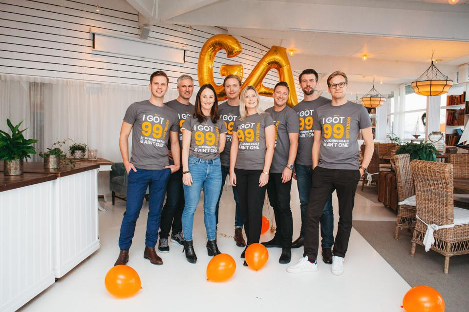 Team at GetAccept wearing T-shirts that say, ″I got 99 problems, but closing deals ain't one.″