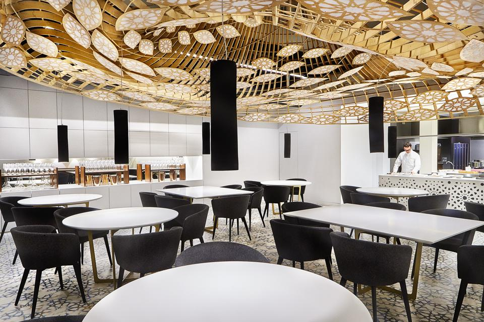 The dining room at Noor restaurant in Spain has a dramatic, geometric light fixture.