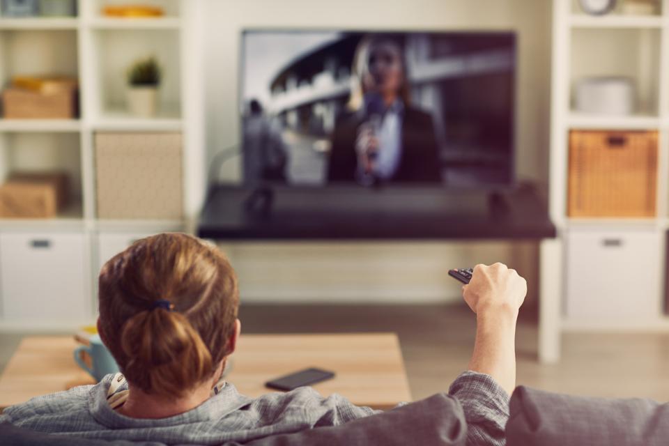 Man Watching Big Screen TV