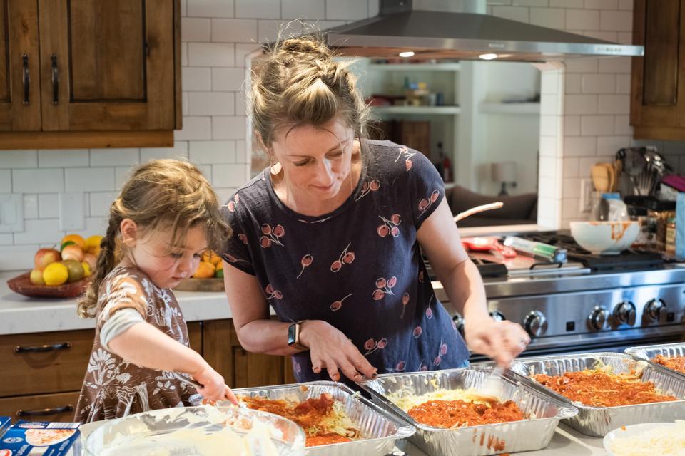 mama daughter making lasagna