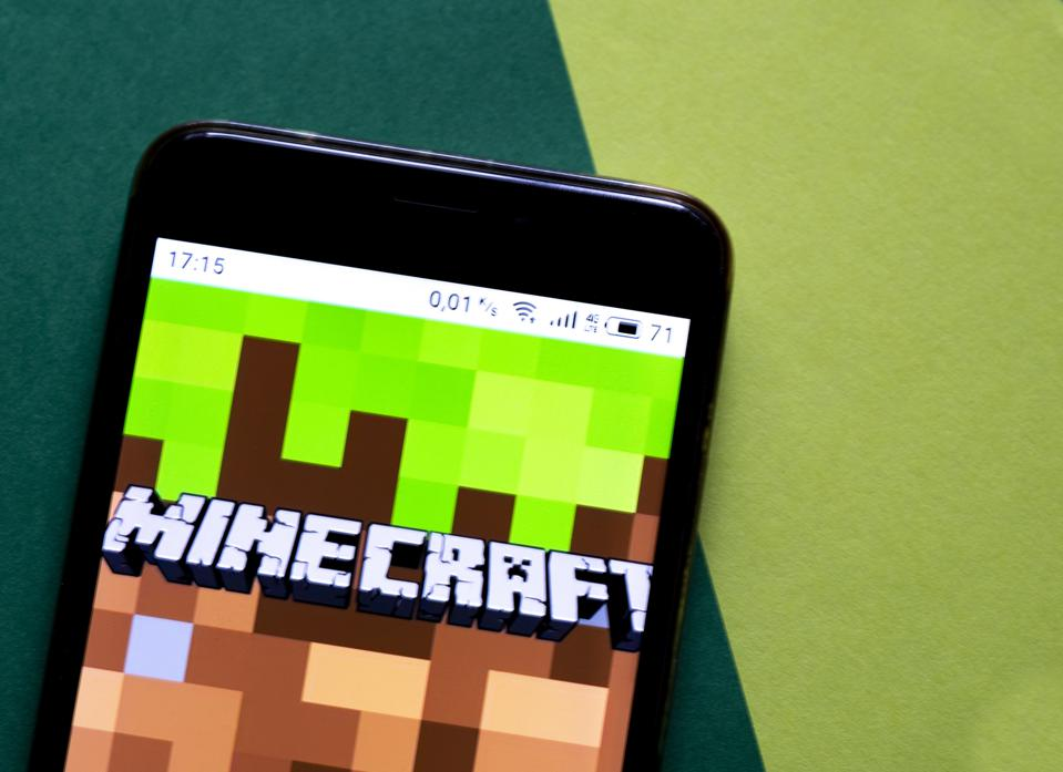 photo illustration of Minecraft video game by Mojang...