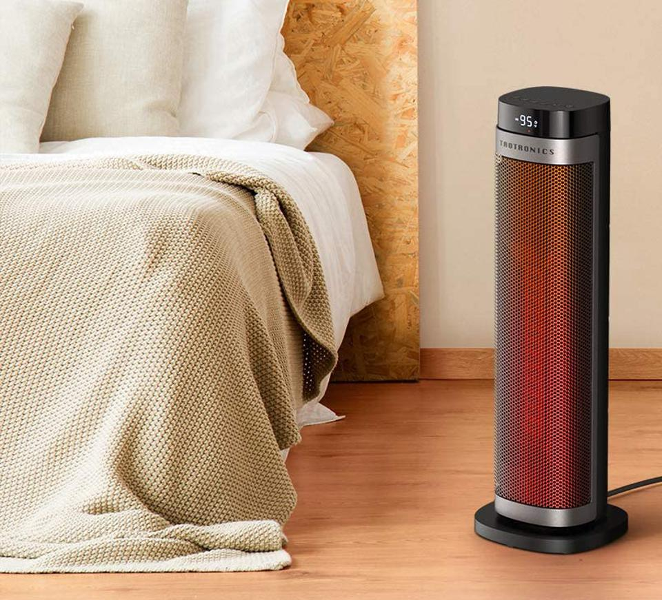 TaoTronics PTC space heater set up next to a bed