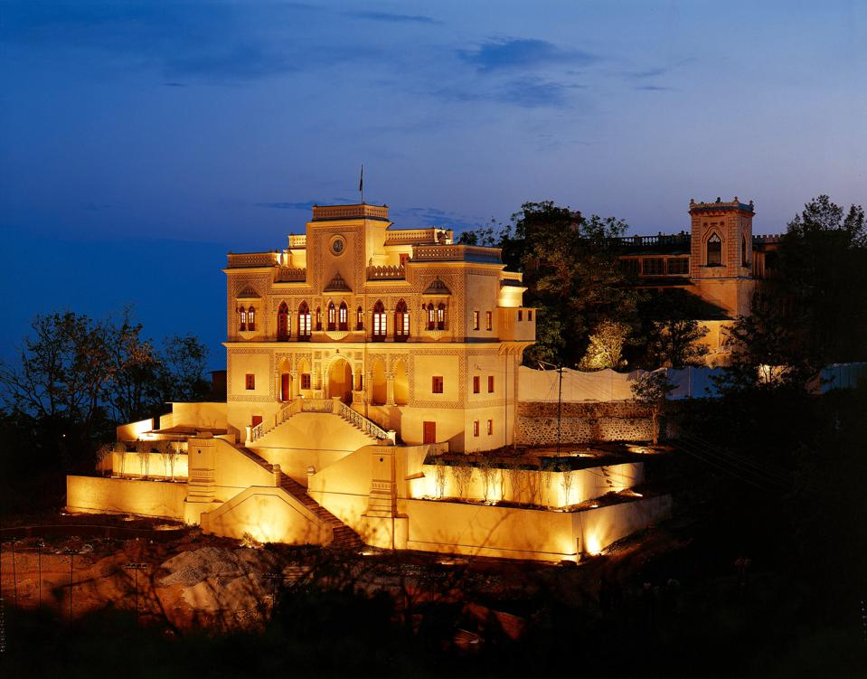 An elaborate Indian palace lit in the evening