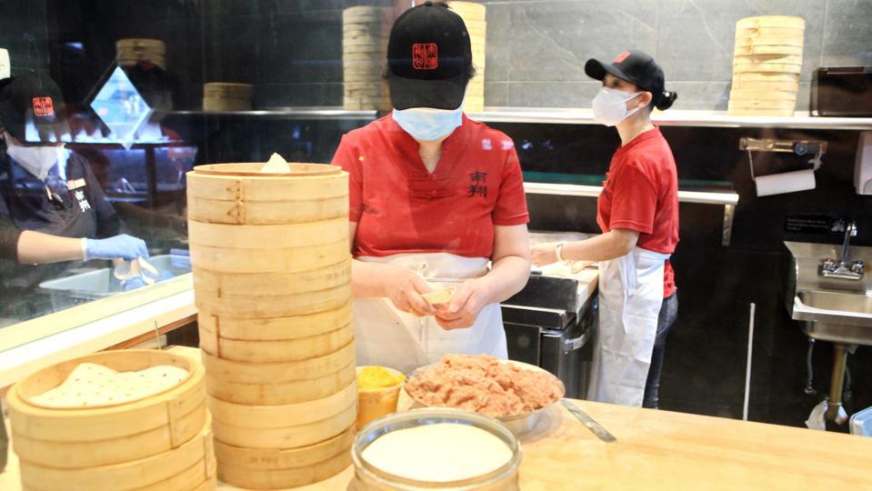 Restaurant workers in the kitchen at Nan Xiang Xiao Long Bao