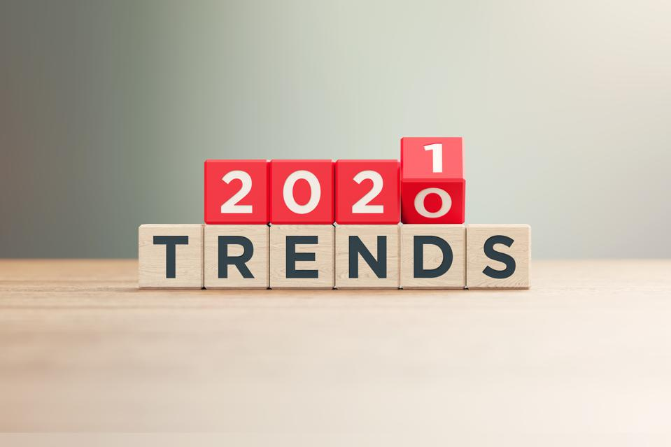 ″2020″ and ″2021 Trends″ Written Red Wood Blocks Sitting on Wood Surface