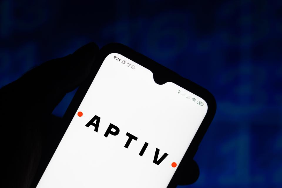 In this photo illustration the APTIV logo seen displayed on...
