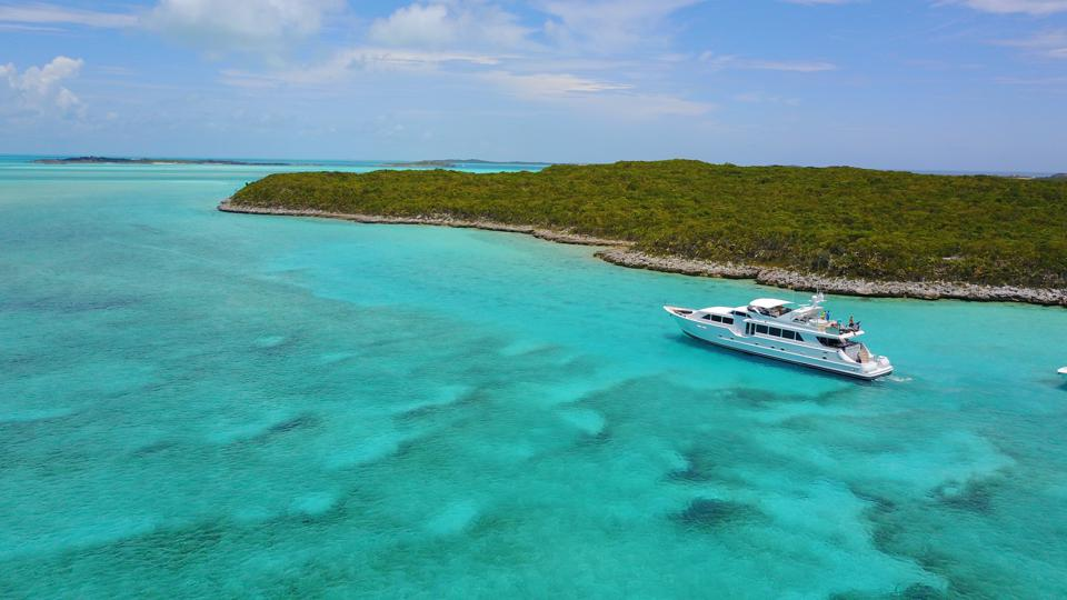 A yacht near a reef in the Bahamas.