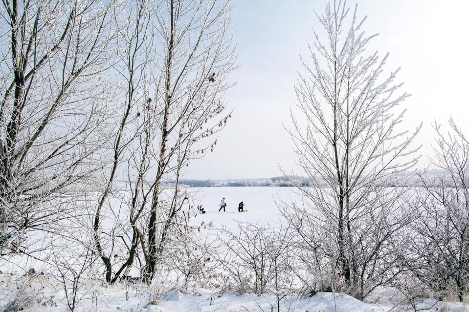 Ice fishing on a lake in the Finger Lakes of New York.