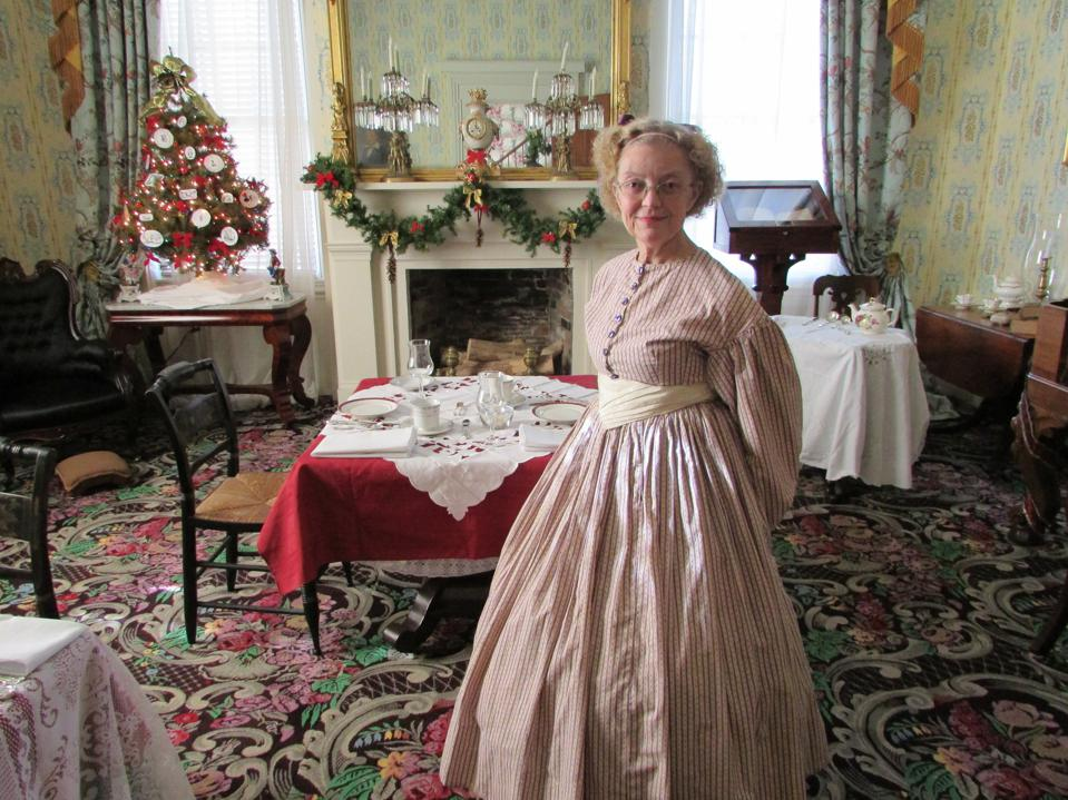 A woman dressed in a century costume at a Lexington hotel.