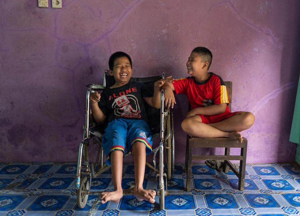 Syaiful (left), 12, and his best friend, Kevin, 9, attend a UNICEF-supported inclusive education program at Madrasah Ibtidaiyah 1 Ciberem in Banyumas, Central Java, Indonesia.