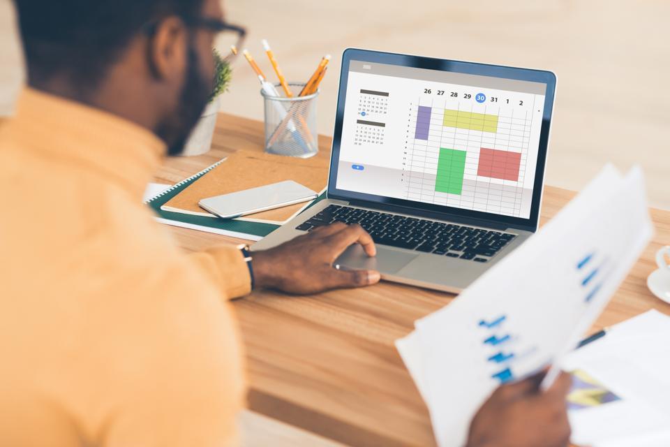 Businessman using online calendar