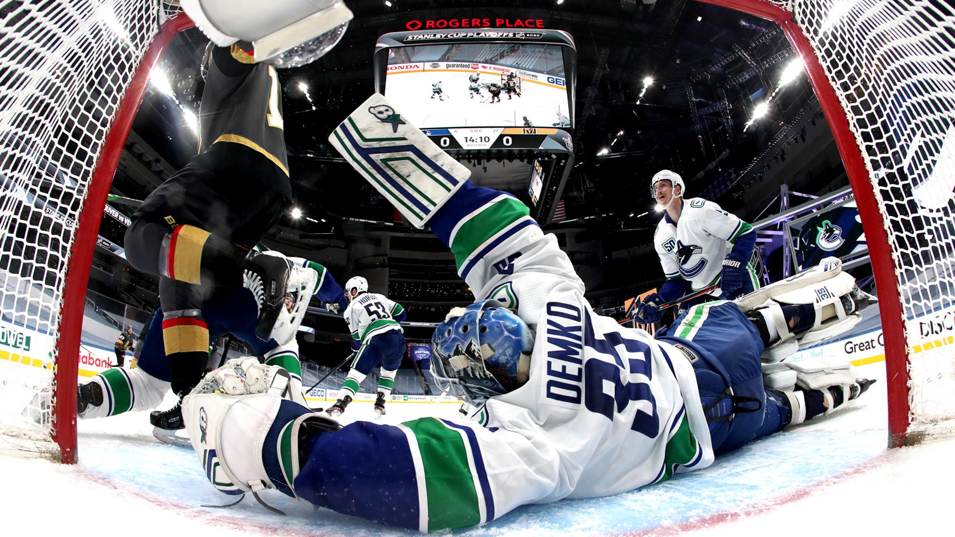 EDMONTON, ALBERTA - SEPTEMBER 04:  Goaltender Thatcher Demko #35 of the Vancouver Canucks stretches to make the save against the Vegas Golden Knights during the third period of Game Seven of the Western Conference Second Round of the 2020 NHL Stanley Cup Playoffs at Rogers Place on September 04, 2020 in Edmonton, Alberta. (Photo by Dave Sandford/NHLI via Getty Images)
