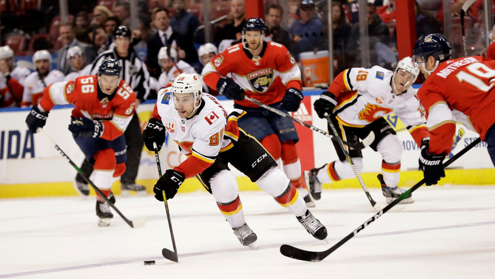 Calgary Flames left wing Andrew Mangiapane (88) takes the puck down the ice during the first period of an NHL hockey game against the Florida Panthers, Sunday, March 1, 2020, in Sunrise, Fla. (AP Photo/Wilfredo Lee)