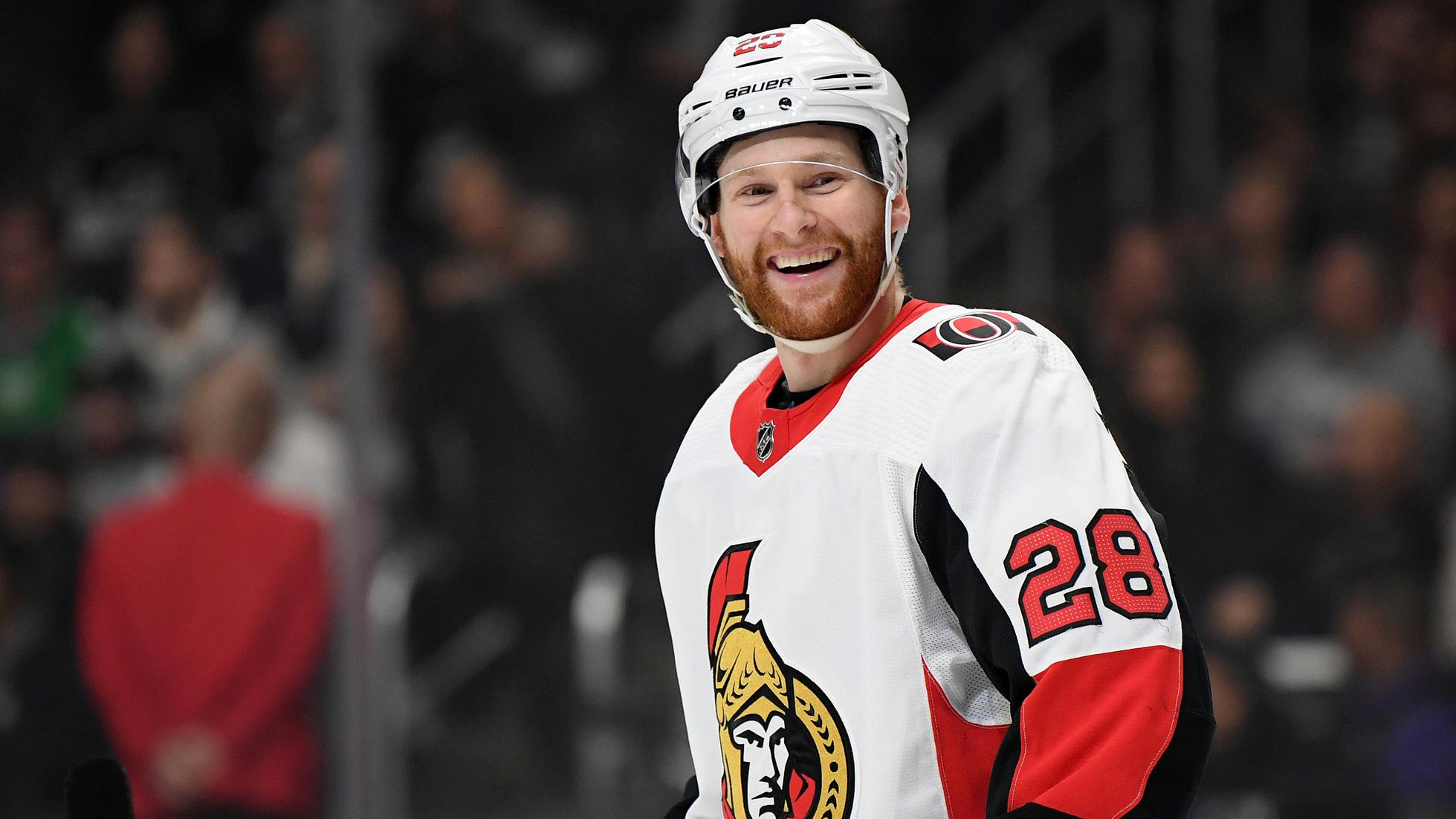 LOS ANGELES, CALIFORNIA - MARCH 11:  Connor Brown #28 of the Ottawa Senators laughs before a face off during the second period against the Los Angeles Kings at Staples Center on March 11, 2020 in Los Angeles, California. (Photo by Harry How/Getty Images)